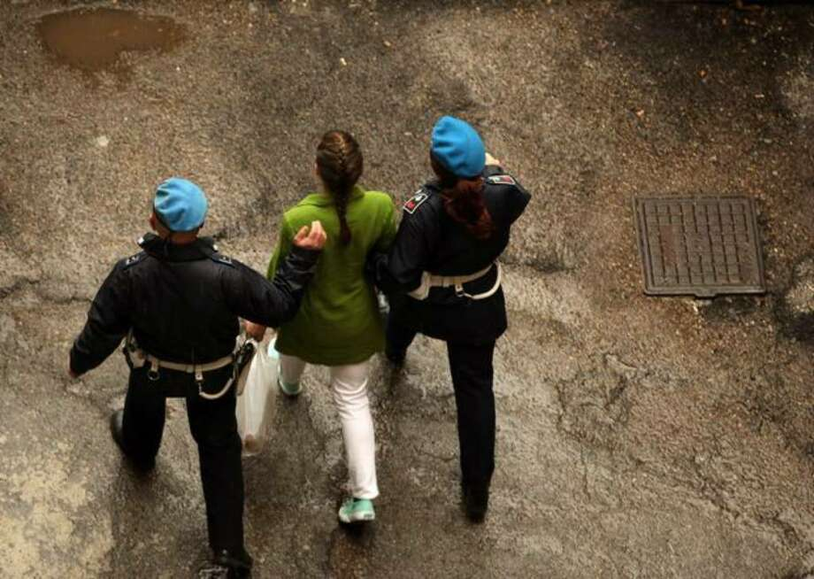 Defendant Amanda Knox (center) is escorted away from court at the end of the final day of the Meredith Kercher murder trial on Dec. 4, 2009 in Perugia, Italy. Photo: / Getty Images