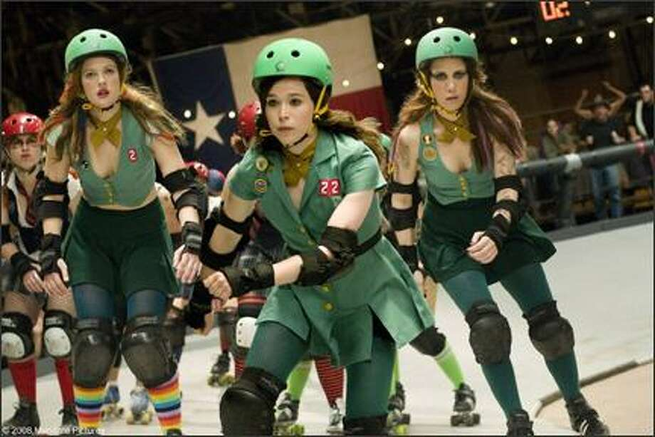 "From left: Drew Barrymore as Smashley Simpson, Ellen Page as Bliss Cavendar and Kristen Wiig as Maggie Mayhem in ""Whip It."""