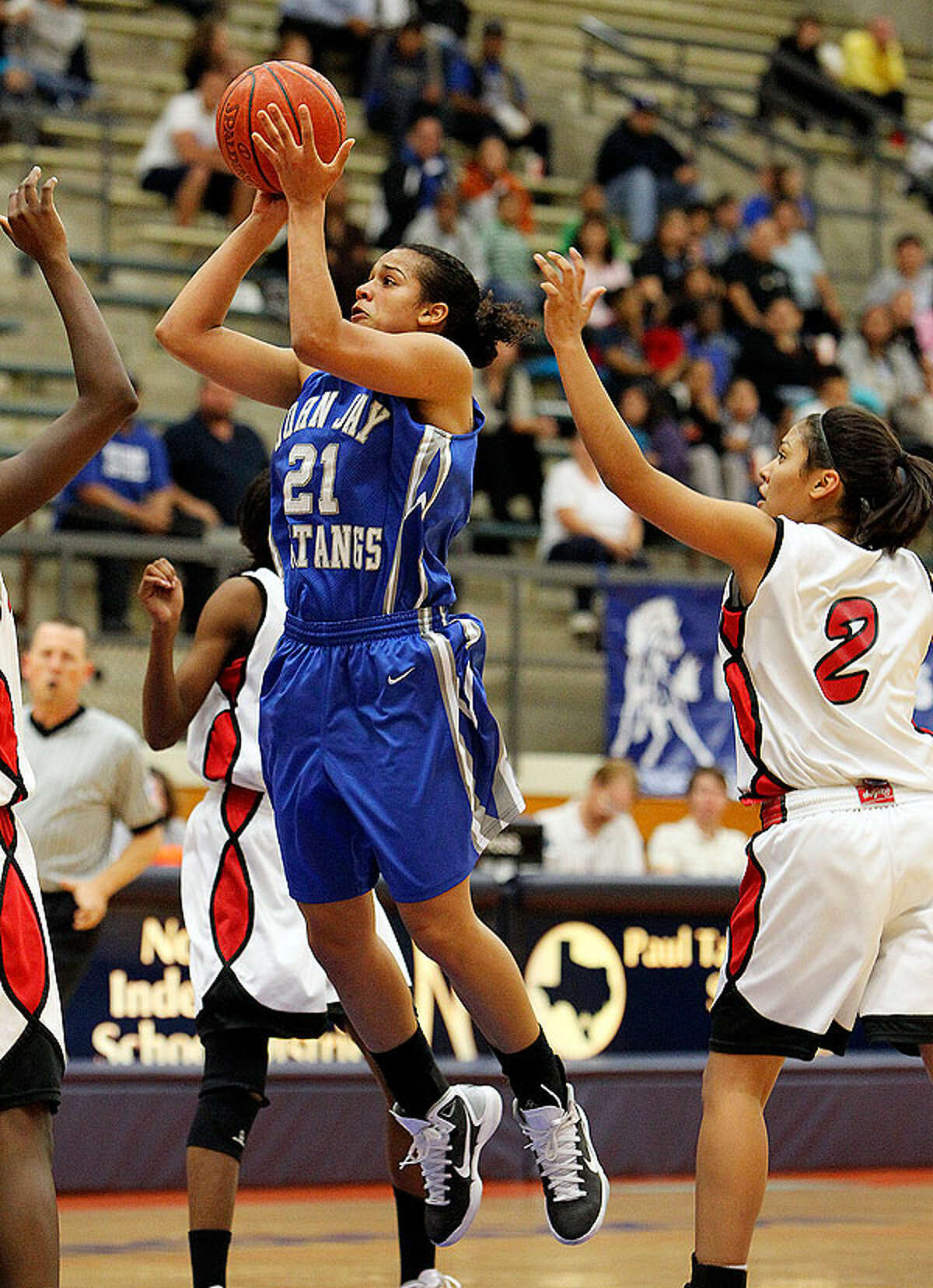 Jay's Erica Donovan (21) takes a shot against Stevens' Alexis Sendejo (02) in girls basketball at Paul Taylor Fieldhouse on Tuesday, Dec. 14, 2010. Jay defeated Stevens, 59-53.