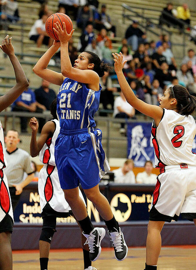 Jay's Erica Donovan (21) takes a shot against Stevens' Alexis Sendejo (02) in girls basketball at Paul Taylor Fieldhouse on Tuesday, Dec. 14, 2010. Jay defeated Stevens, 59-53. Photo: Kin Man Hui/kmhui@express-news.net, Express-News