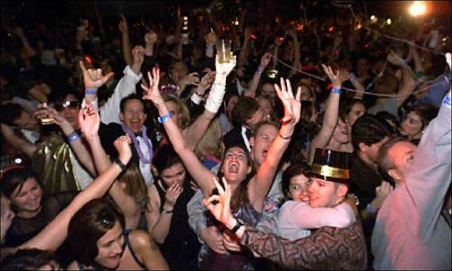 "Revelers at the ""Center of the Universe Ball"" in Fremont rejoice as the clock ticks into the new year on Dec. 31, 1999. Photo: / P-I File"