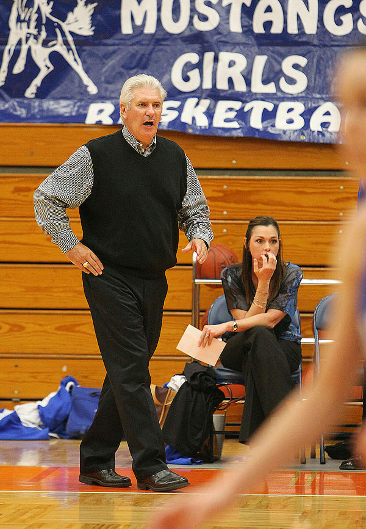 Jay coach Mike Floyd (left) gives directions in the closing moments of their game against Stevens in girls basketball at Paul Taylor Fieldhouse on Tuesday, Dec. 14, 2010. Jay defeated Stevens, 59-53.