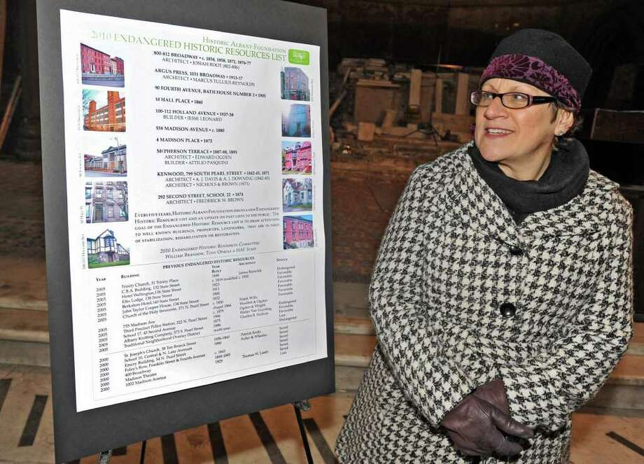 Susan Holland, executive director for Historic Albany Foundation, stands next to a poster with the 2010 Endangered Historic Resources List after a press conference in Albany.  (Lori Van Buren / Times Union) Photo: Lori Van Buren