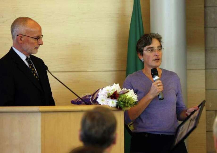 """Merril Cousin, executive director of the King County Coalition Against Domestic Violence, was among those who received awards Tuesday at Seattle City Hall during a ceremony that was part of Domestic Violence Awareness Month. City Councilman Tim Burgess, left, said the council """"will be taking very strong steps"""" to restore funding for domestic violence programs. Photo: Casey McNerthney/seattlepi.com"""