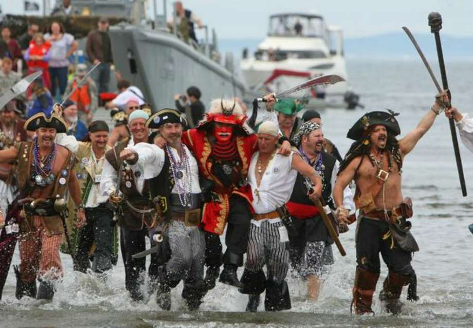 The Seafair Pirates still terroize the crowds, such as this time when they hit Alki Beach in 2008. Photo: / P-I File