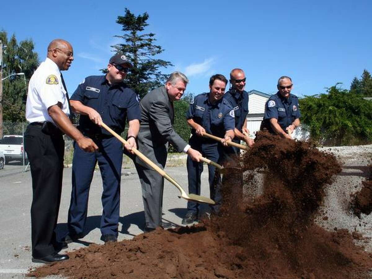 Seattle Fire Chief Gregory Dean, left, and Mayor Greg Nickels, in suit, at a Thursday groundbreaking ceremony for station 38.