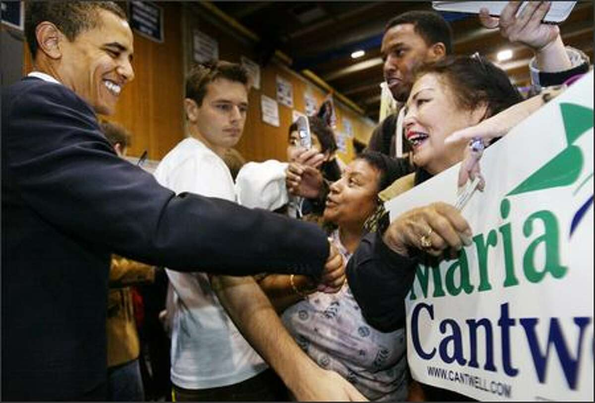 Enthusiastic supporters greet then-Sen. Barack Obama after he spoke at a rally supporting Sen. Maria Cantwell, D-Wash., and U.S. House candidate Darcy Burner at Bellevue Community College on Oct. 26, 2006.