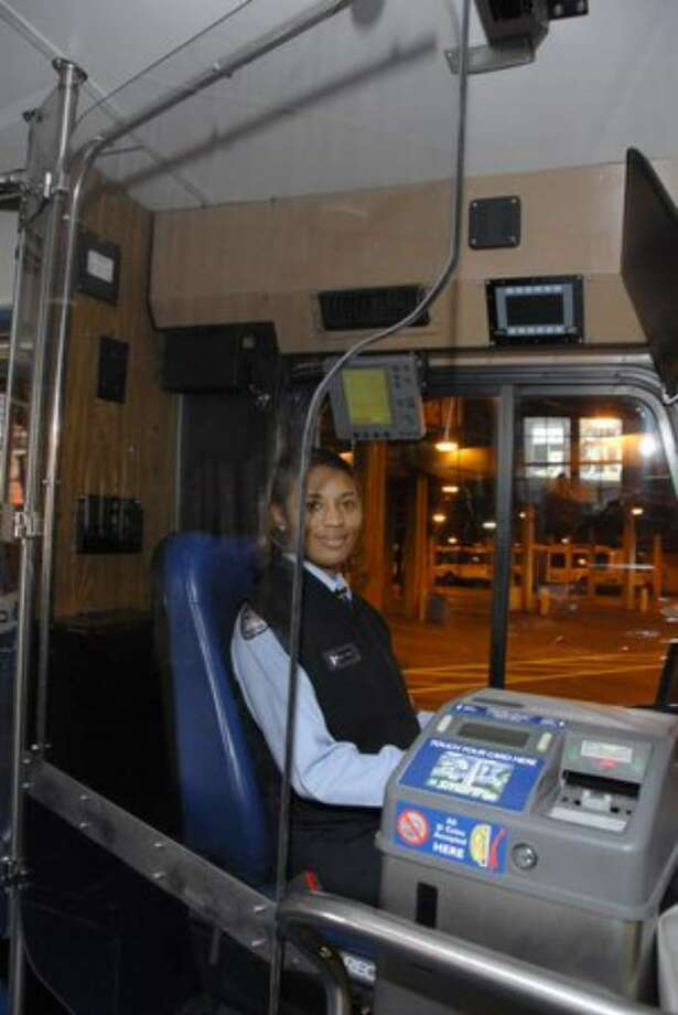 King County Metro plans to test Plexiglas shields as a way to protect bus drivers. This photo was provided by the Washington Metropolitan Area Transit Authority, which tried a pilot project in 2008. Photo: /