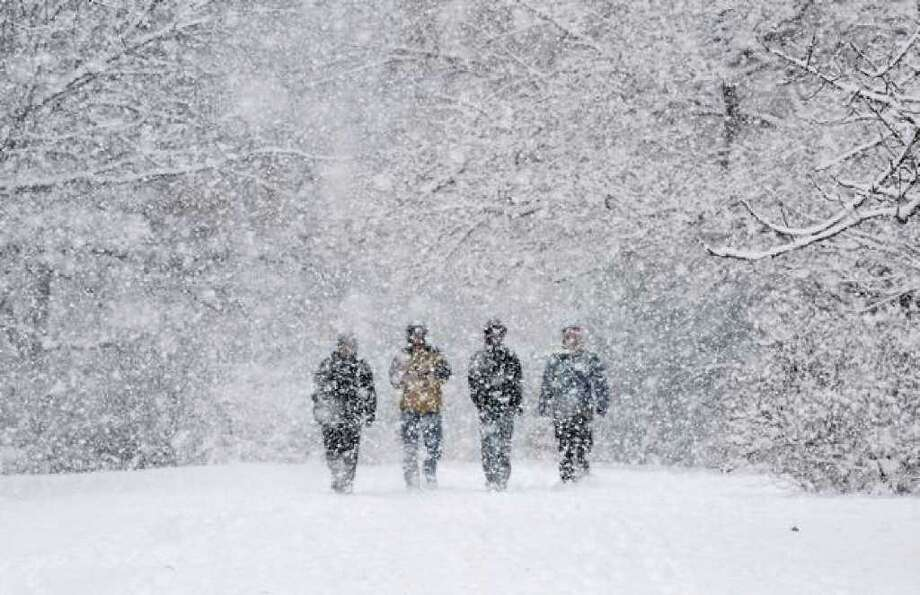 Heavy snow, coming down in large flakes, obscures visitors as they walk in the Washington Park Arboretum in Seattle in this December 2008 file photo. (Seattle Post-Intelligencer/Dan DeLong) Photo: / P-I File