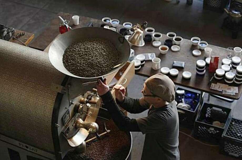 Joel Edwards works the roaster at Ritual Coffee Roasters, which uses GoCoffeeGo. (Lea Suzuki / San Francisco Chronicle) Photo: / San Francisco Chronicle