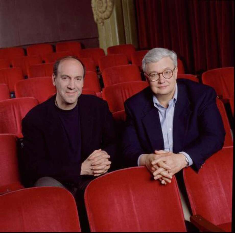 Film critics Roger Ebert (right) and the late Gene Siskel in a promotional photo for one of their TV shows taken in 1996. Photo: / CBS