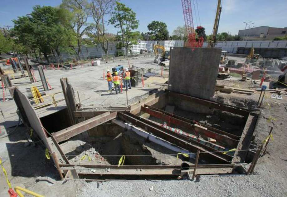 A pit exposes utilities being relocated on a closed section of East Denny Way during a tour of the future site of Sound Transit's Capitol Hill light rail station on Friday, May 14, 2010. The station is planned to open in 2016. Photo: Joshua Trujillo/seattlepi.com