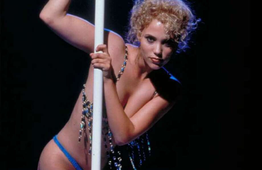 "Actress Elizabeth Berkley as Nomi Malone in ""Showgirls"" (1995), a film as noteworthy for its copious and gratuitous nudity as for its cheesy acting and dubious plot. Photo: /"