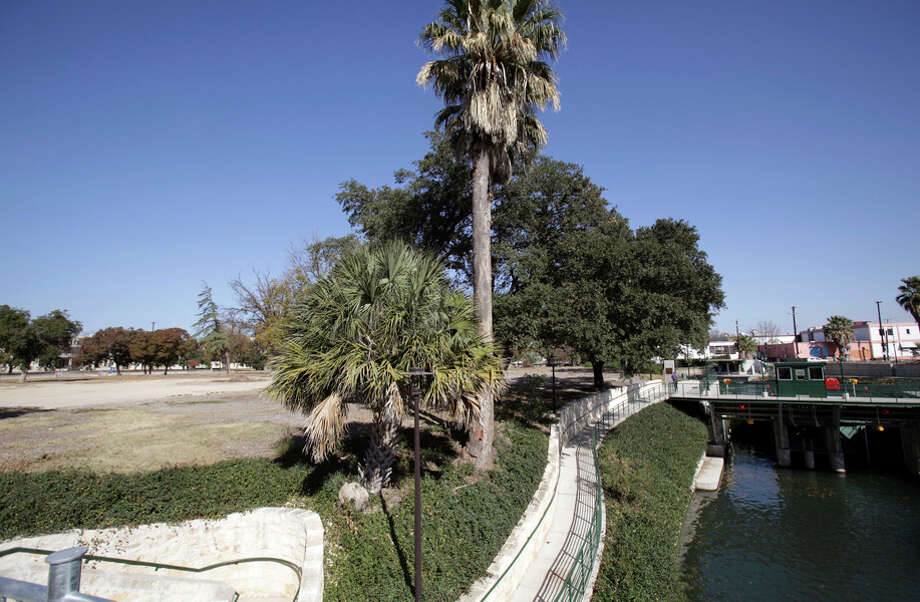 The San Antonio Housing Authority owns the land at left that overlooks the locks on the Museum Reach segment of the river. Photo: Bob Owen / San Antonio Express-News