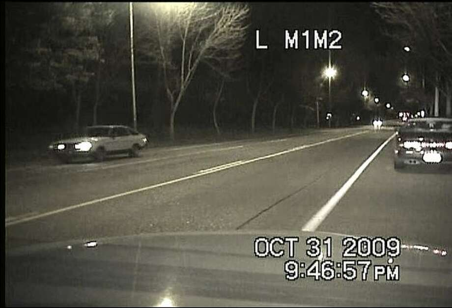 A Datsun sought by police, at left, shown 20 minutes before the fatal Oct. 31 shooting of Officer Tim Brenton. The car appears to be on Martin Luther King Jr Way. (Seattle Police Department photo) Photo: /