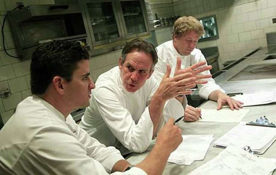 French Laundry executive chef Thomas Keller, center, confers with his chef de cuisine, Timothy Hollingsworth, right, and sous chef Anthony Secviar, left, as the team of chefs changes the menu. Photo: Lance Iversen/San Francisco Chronicle
