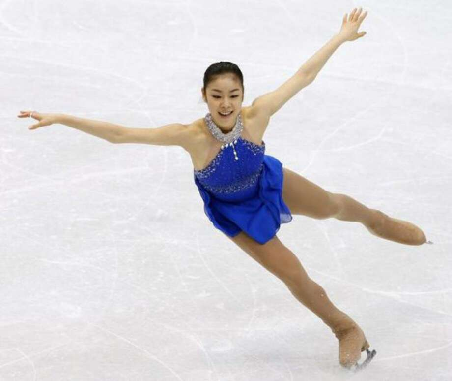 Yu-Na Kim of South Korea performs in the free program of the women's figure skating competition at the Winter Olympics in Vancouver, B.C. on Thursday, Feb. 25, 2010. Photo: / Hearst Newspapers