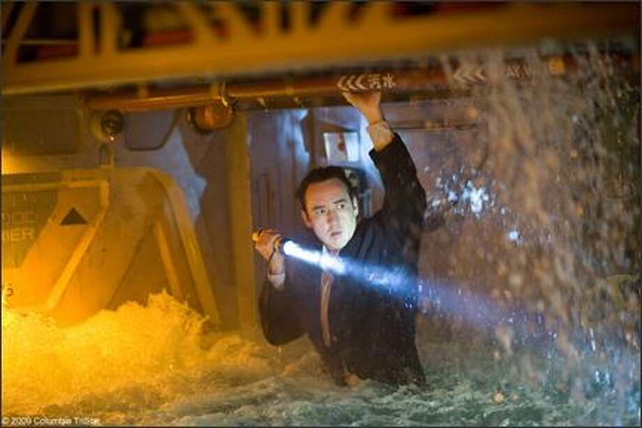 "John Cusack faces the End Times in ""2012,"" a thriller built around the fact that the current era of the Mayan calendar ends Dec. 21, 2012. In this movie, neutrinos from a massive solar flare are causing the temperature of the Earth's core to increase."
