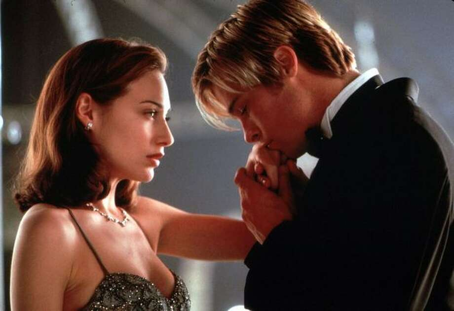 """So OK, this isn't some long-standing couple that needs to rekindle a flame. It's Claire Forlani and Brad Pitt in a scene from the movie """"Meet Joe Black."""" But you have to admit, they look pretty intimate. Photo: / Getty Images"""
