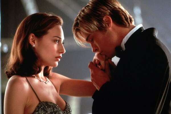 """So OK, this isn't some long-standing couple that needs to rekindle a flame. It's Claire Forlani and Brad Pitt in a scene from the movie """"Meet Joe Black."""" But you have to admit, they look pretty intimate."""