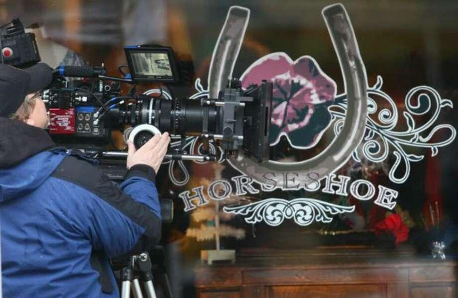 "A camera crew shoots a scene during filming of the movie ""Late Autumn"" along Ballard Avenue Northwest on Jan. 14. Photo: Joshua Trujillo/seattlepi.com"