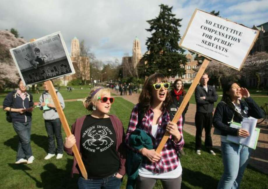 UW students Sienna Hiebert and Becca Pope participate in the strike against increased tuitions and upcoming state budget cuts for colleges in the Quad at the University of Washignton. Photo: Thom Weinstein/seattlepi.com