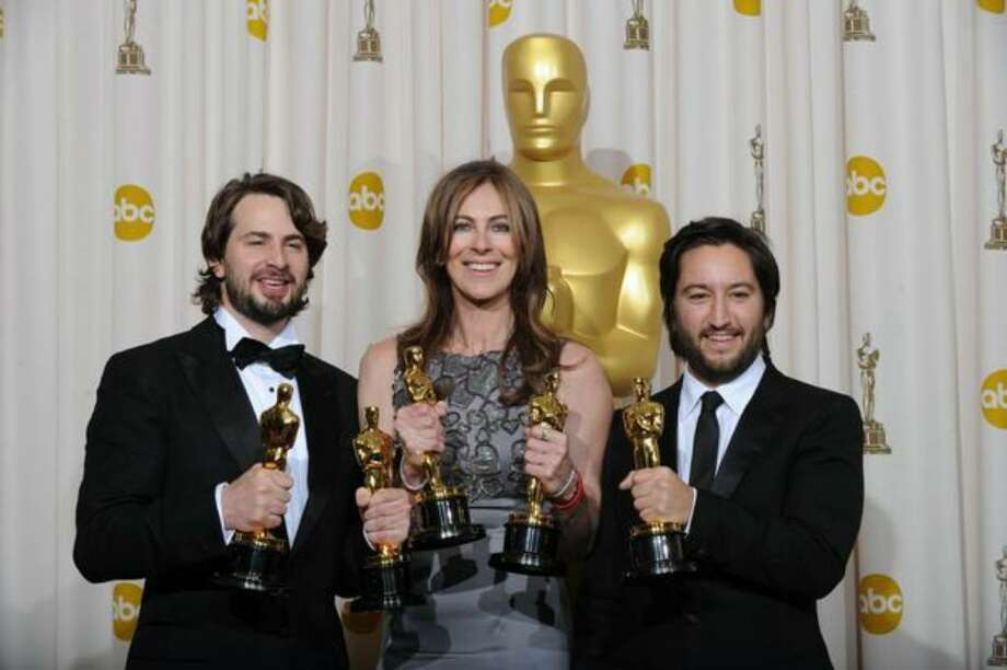 """From left, producer/screenwriter Mark Boal, director Kathryn Bigelow and producer Greg Shapiro celebrate the Best Picture Oscar for """"The Hurt Locker"""" at the 82nd Academy Awards at the Kodak Theater in Hollywood, Calif., on Sunday, March 7, 2010. (Photo by Mark Ralston/AFP/Getty Images) Photo: / Getty Images"""