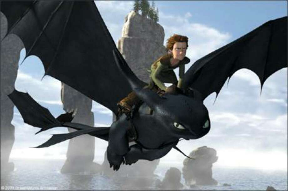 "Hiccup (voice of Jay Baruchel) astride dragon Toothless in ""How to Train Your Dragon."""