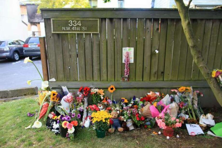 A makeshift memorial grows at 334 N.W. 41st St. in Fremont on Monday, two days after a fire there killed five people, including four children. Photo: Joshua Trujillo/seattlepi.com