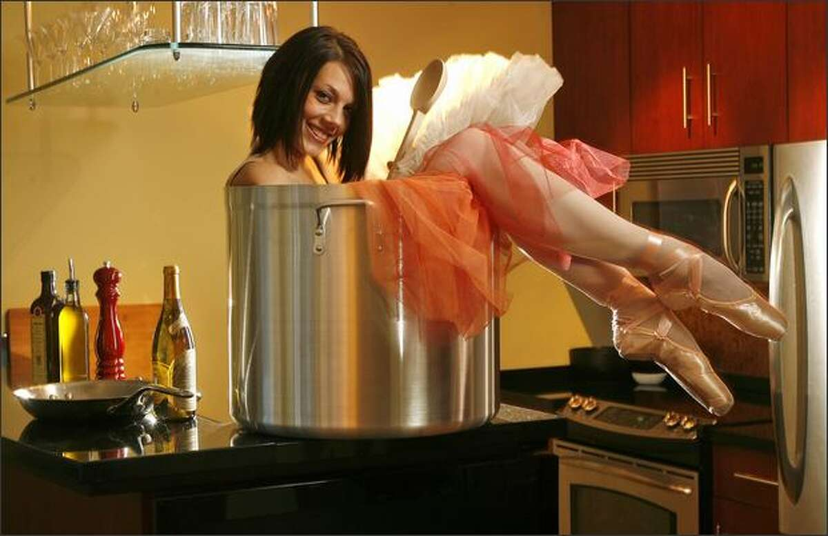 Former Pacific Northwest Ballet dancer Kari Brunson makes the best of her tiny kitchen in this February 2008 photo. For more on this photo: click here.