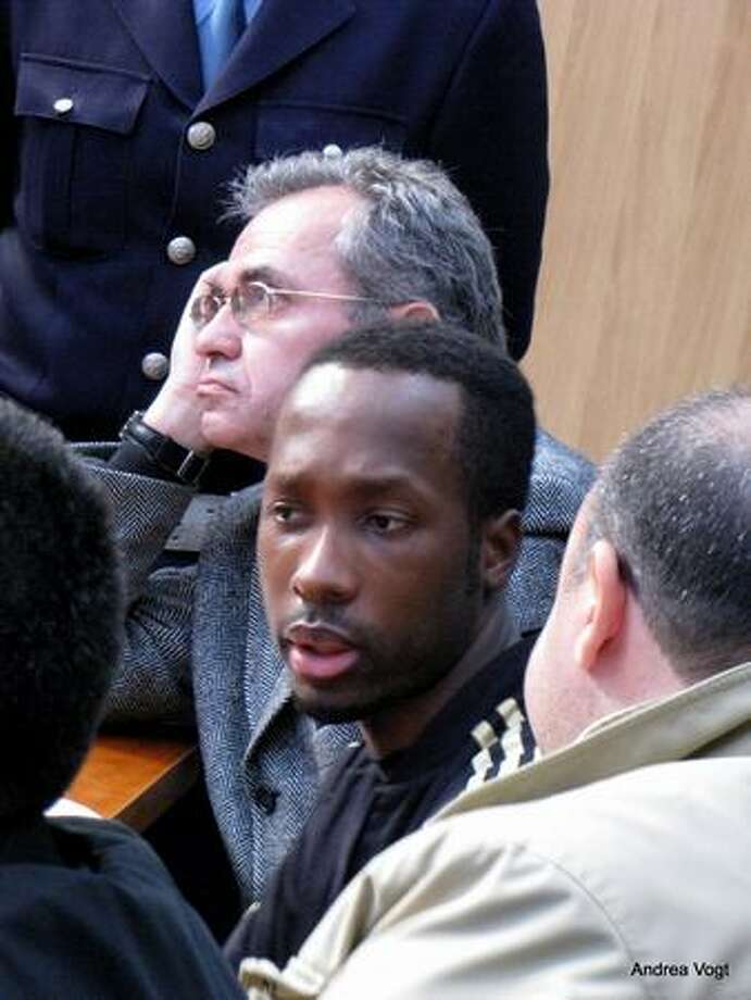 Rudy Guede in court in Viterbo, Italy, accompanied by his attorneys, Walter Biscotti and Nicodemo Gentile. Photo: Andrea Vogt/Special To Seattlepi.com