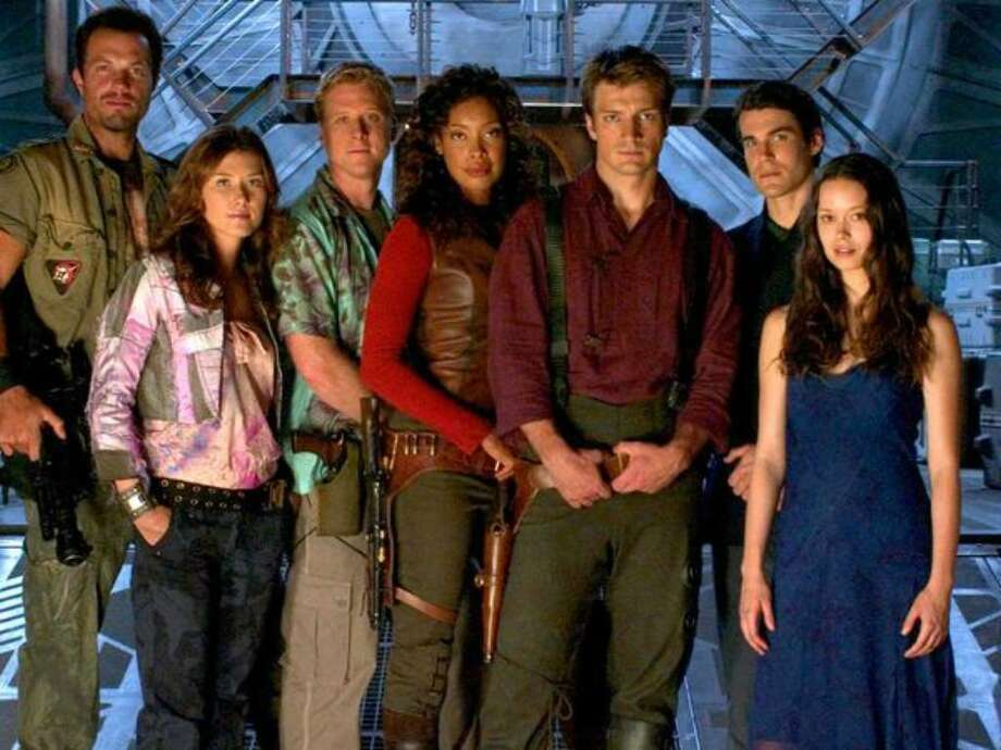 """The crew of """"Serenity"""" (2005), from left: Jayne (Adam Baldwin), Kaylee (Jewel Staite), Wash (Alan Tudyk), Zoe (Gina Torres), Captain Mal Reynolds (Nathan Fillion), Dr. Simon Tam (Sean Maher) and River Tam (Summer Glau). Photo: / Universal Pictures"""