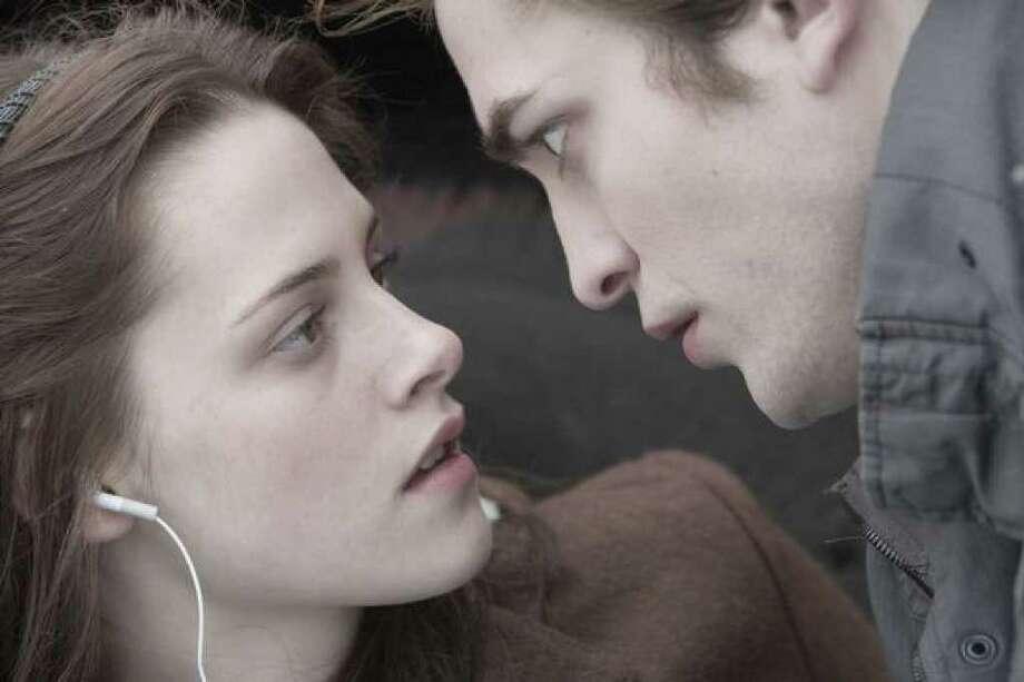 "Edward (Robert Pattinson) saves Bella (Kristen Stewart) in ""Twilight."" Photo: / Summit Entertainment"