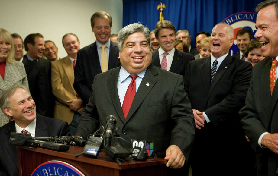 State Rep. Aaron Pena of Edinburgh (at lectern) announces his switch from the Democratic Party to the GOP during a news conference at the Republican Party of Texas headquarters in Austin. He was joined in moving to the Republican column by state Rep. Allan Ritter of Nederland (in background, to the right of Gov. Rick Perry). Photo: Associated Press/Austin American-Statesman Jay Janner