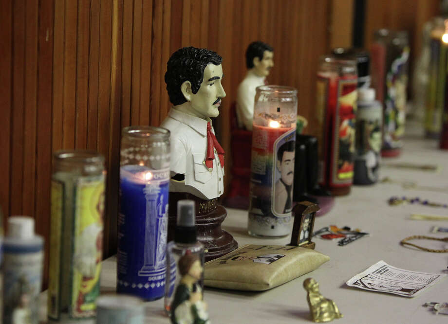 A statue of Jésus Malverde, known as the patron saint of narco traffickers, was part of a presentation on the drug underworld for law enforcement held at St. Mary's University. Photo: John Davenport/Express-News