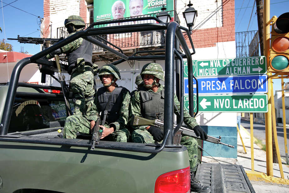 Mexican army troops on patrol. They've set up checkpoints at the entrances to the city and are expected to be there through January. Photo: Edward A. Ornelas/Express-News