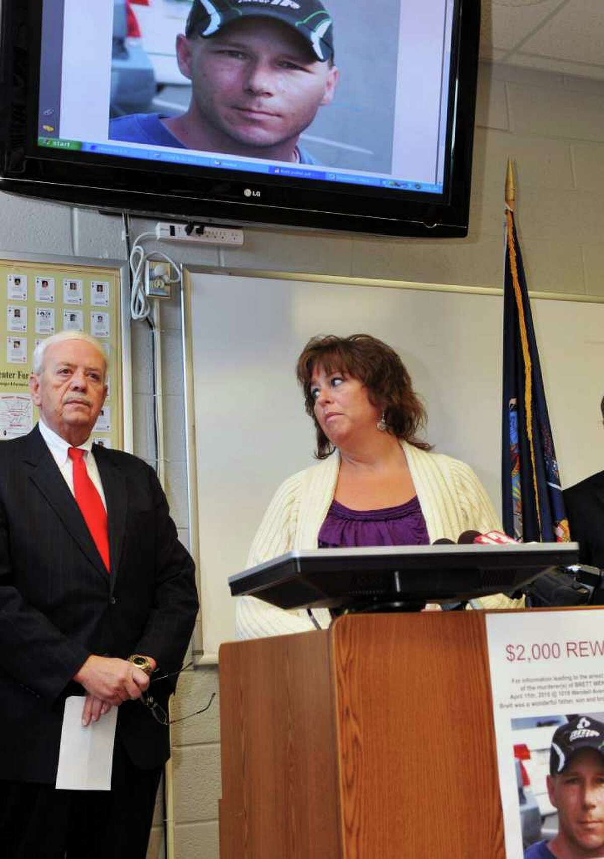 Margaret Messer of Niskayuna, sister of murder victim Brett Wentworth joins Schenectady Public Safety Commisser Wayne Bennett, left, at a news conference at the Schenectady Police Dept. appealing for the public's help Tuesday. Wentworth was discovered dead last year in his Wendell Avenue apartment. (John Carl D'Annibale / Times Union)