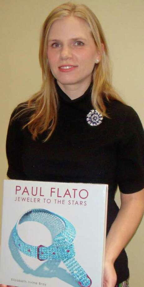 Elizabeth Irvine Bray with her new book about Paul Flato, the go-to jeweler of Hollywood stars in the 1930s. The Westport native discussed the book at the Westport Library. Photo: Contributed Photo/Mike Lauterborn / Westport News