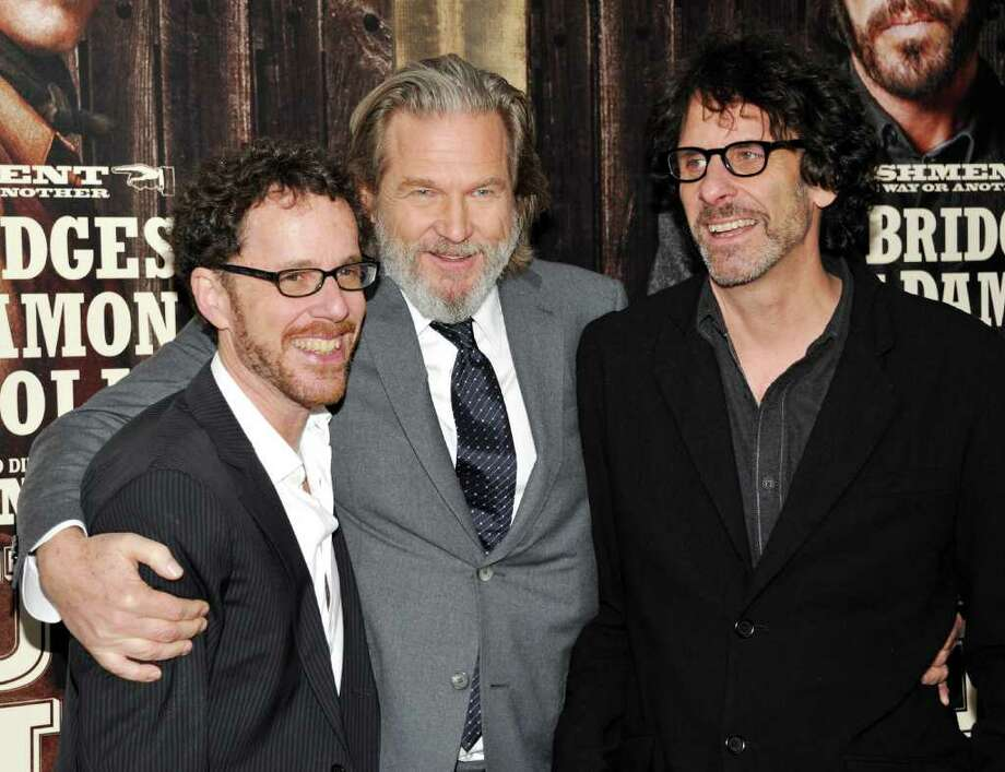 Actor Jeff Bridges, center, poses with co-directors Ethan Coen, left, and Joel Coen at the premiere of 'True Grit' at the Ziegfeld Theatre on Tuesday, Dec. 14, 2010 in New York. (AP Photo/Evan Agostini) Photo: Evan Agostini