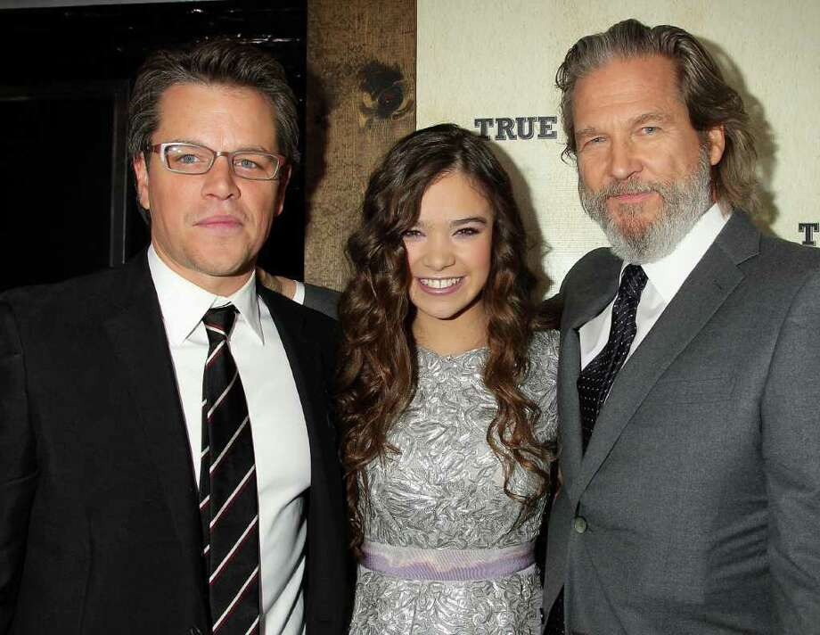 "In this photo released by Starpix, ""True Grit"" stars Matt Damon, left, Hailee Steinfeld and Jeff Bridges stop for a photo at the New York Premiere of their film, Tuesday, Dec. 14, 2010. (AP Photo/Starpix, Dave Allocca) Photo: DAVE ALLOCCA"