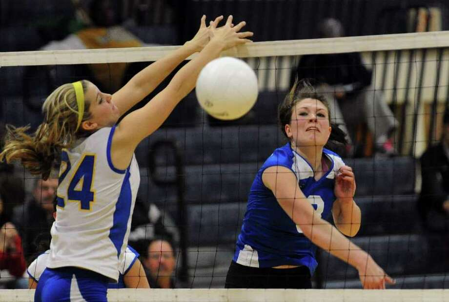 Fairfield Ludlowe's #3 Madison McCaffrey, right, spikes the ball past Mercy's #24 Amber Bepko, during CIAC Class LL semi-final volleyball action in East Haven, Conn. on Thursday November 18, 2010. Photo: Christian Abraham, ST / Connecticut Post