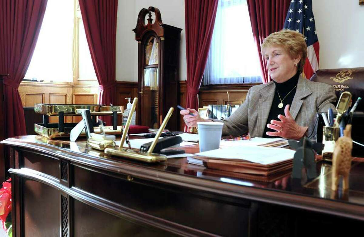 Gov. M. Jodi Rell its at her desk in her office at the Captial in Hartford Tuesday, Dec. 14, 2010.