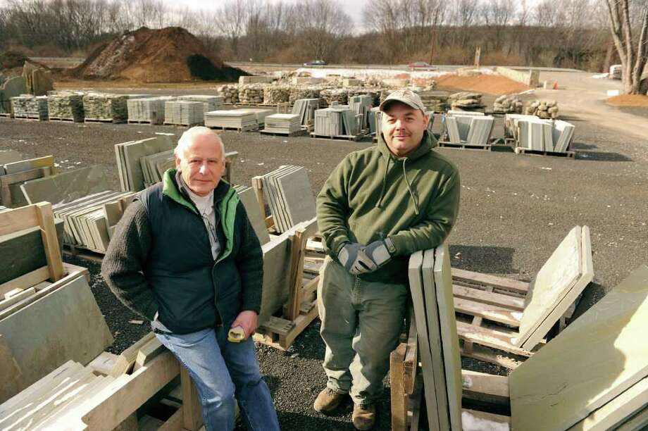 Jim Giess, left, general sales manager and Brendon Southard, owner of Grays Bridge Farm & Earth Products in Brookfield. Both men are Bridgewater residents. Photo: Carol Kaliff / The News-Times