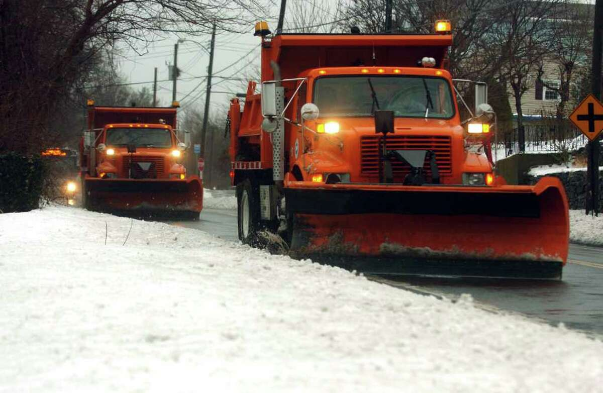 State plows make their way along Edgefield Avenue in Milford, during Wednesday's snow and rainstorm. 1/28/09