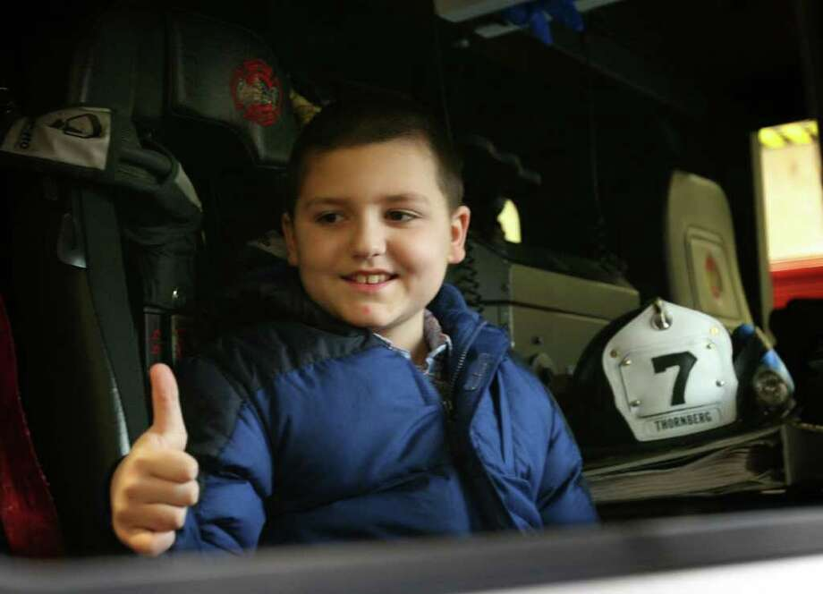 Dylan Fortunato, 8, gives a big thumbs up as he sits in a firetruck for the first time at the Milford Fire Department Station 7 on Wheeler's Farm Road on Feb 11th, 2009. Photo: Brian A. Pounds / Connecticut Post