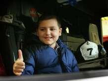 Dylan Fortunato, 8, gives a big thumbs up as he sits in a firetruck for the first time at the Milford Fire Department Station 7 on Wheeler's Farm Road on Feb 11th, 2009.