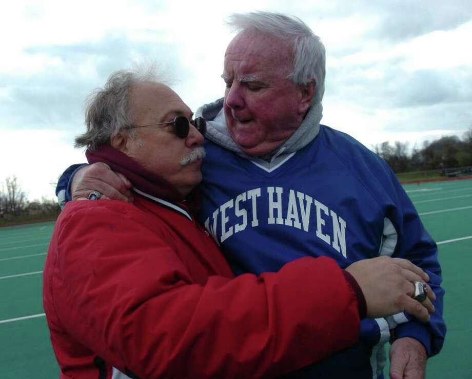 Fairfield Prep head coach Rich Magdon greets West Haven head coach Ed McCarthy at midfield following Thursday game 11/27/08 in West Haven. The game was Magdon's last. West Haven defeated Prep 25-6. Photo: Ned Gerard / Connecticut Post