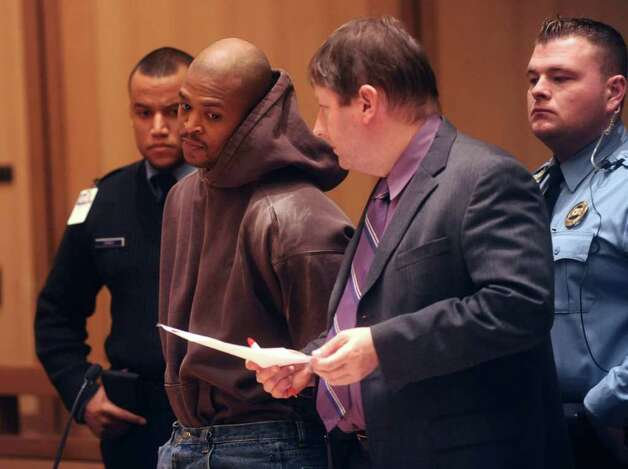 David Wash was arraigned at the state Superior Court in Stamford on Wednesday, Dec. 15, 2010, in connection with two armed robberies in Greenwich and Norwalk in 2009. Second from right is Wash's public defender, Mark Welsh. Photo: Helen Neafsey / Greenwich Time