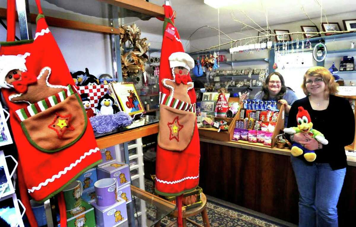 Amy Morrison, new and original owner of The Enchanted Forest, stands with her daughter, Elizabeth, right, in the New Milford shop, Wednesday, Dec. 15, 2010.