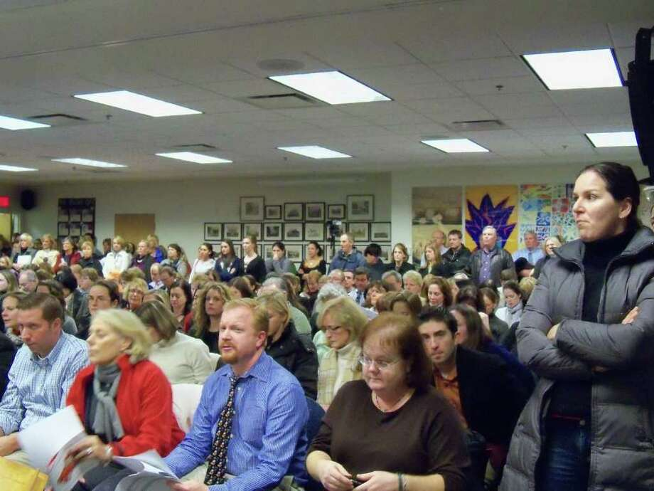 A standing room only crowd, that spilled out into the hallway, packed Tuesday night's school board meeting to hear a presentation of a recently conducted Board of Education operational audit. The board took no action on the recommendations made in the audit. Photo: Genevieve Reilly / Fairfield Citizen